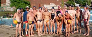 Water polo players standing for a photo after practice.